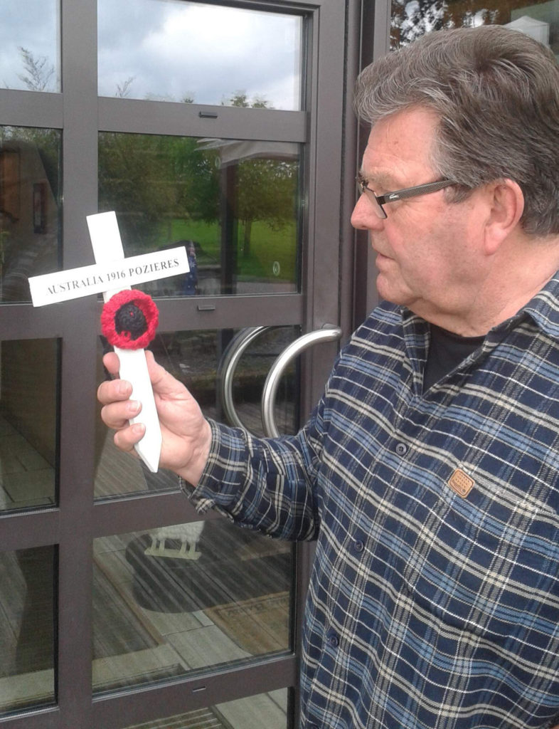Bernard Delattre Mayor of Pozieres looking at the first finished cross off the assembly line